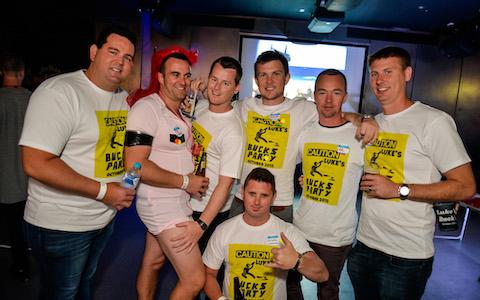 matching t-shirt bucks on pub crawl with buck dressed in drag