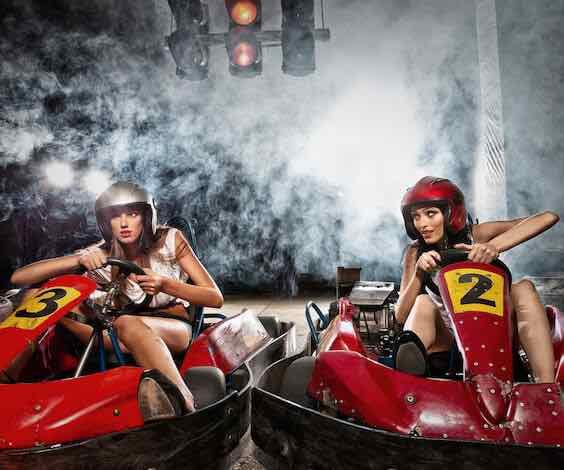 two beautiful waitresses racing go karts
