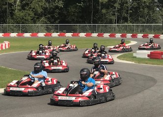 group of bucks racing go karts