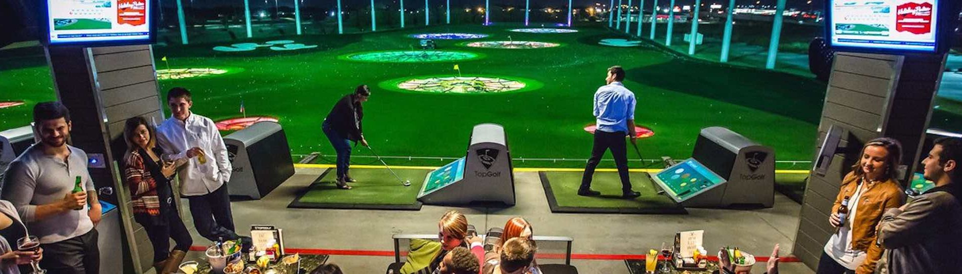 group of bucks playing golf at top golf