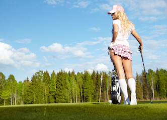 golf bunny showing leg on golf course with clubs
