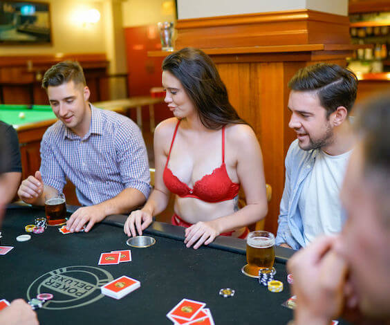group of bucks playing poker with waitresses
