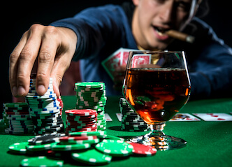 buck playing high rollers poker, drinking whisky and smoking cigar