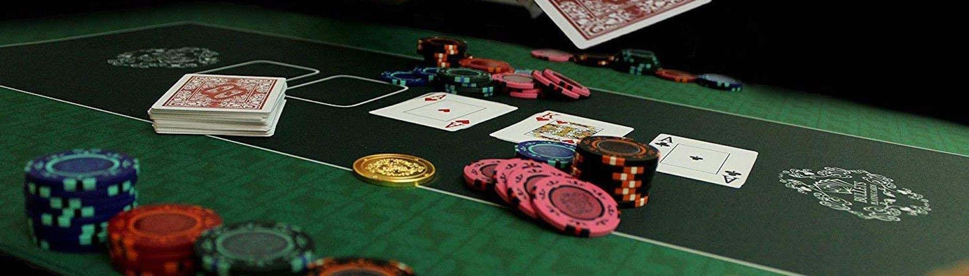 poker chips and cards on poker table of an inroom poker party