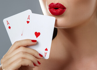 beautiful waitresses holding playing cards