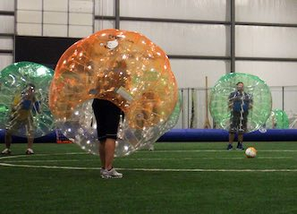 group of bucks playing bubble soccer