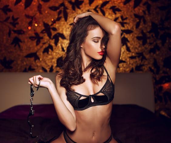 beautiful waitress holding handcuffs