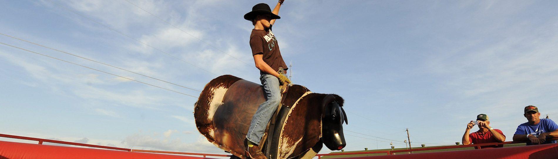 buck riding mechanical bull