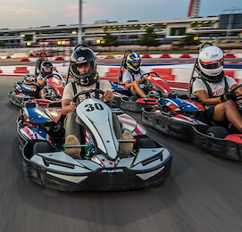 group of bucks racing go-karts