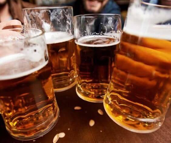 group of bucks cheering four beer glasses