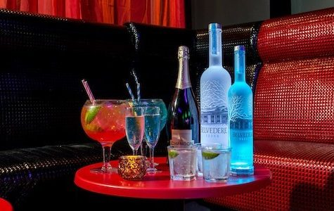 VIP booth in club with spirits and cocktails