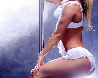 sexy lingerie stripper in white on pole