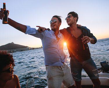 group of bucks drinking on boat cruise