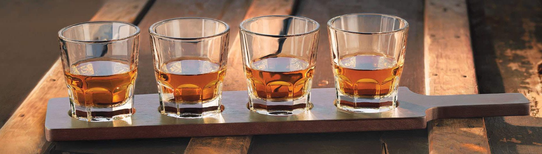 four glasses of whiskey on paddle