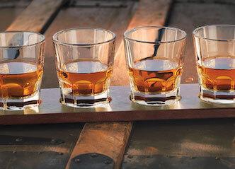 4 glasses of whiskey on paddle