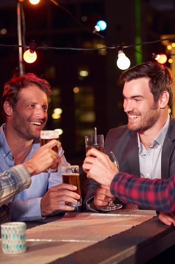 group of bucks drinking beer at a bar