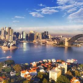 aerial view of sydney harbour and sydney city with bright blue skies in the background