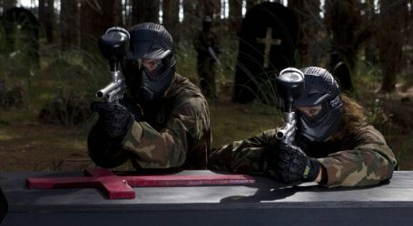 two people playing paintball
