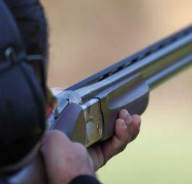 man shooting clay targets with gun
