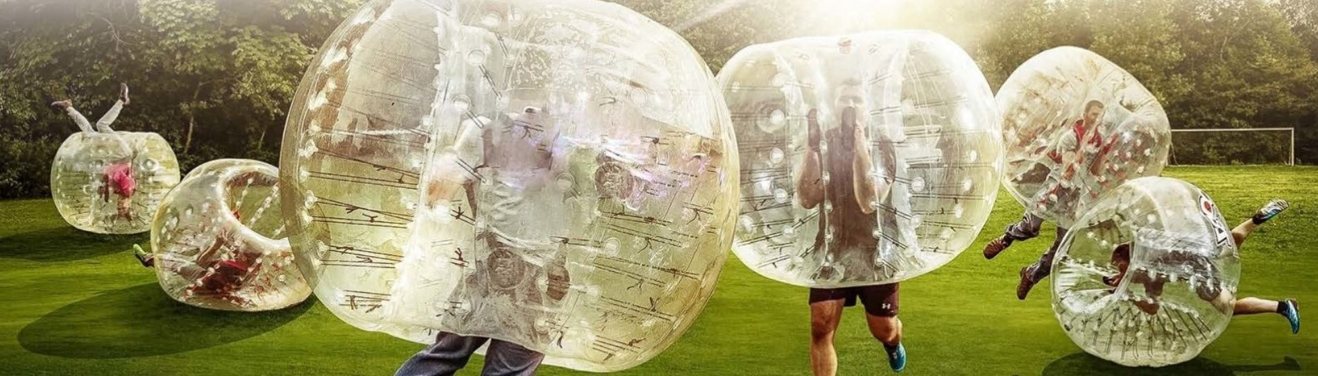 guys playing bubble soccer outside