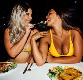 girls feeding each other schnitzel