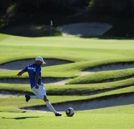 guy playing footgolf on golf field